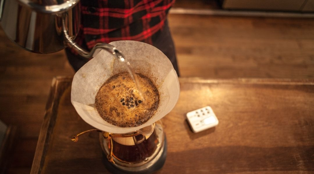person making pour over coffee